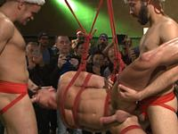 Muscled Submissive Bound in Public